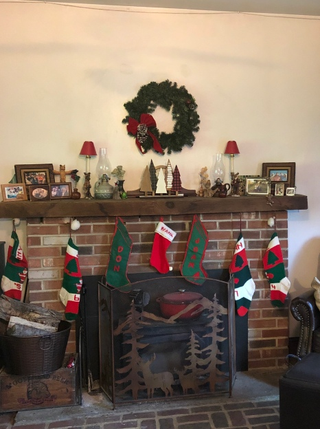 Our mantel, 2018, DH's original stocking from 1956 on left.